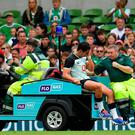 Joey Carbery can't hide his anguish as he is taken off with an ankle injury. Photo: Seb Daly/Sportsfile