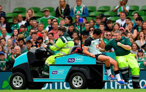 Rugby Joey Carbery can't hide his anguish as he is taken off with an ankle injury. Photo: Seb Daly/Sportsfile