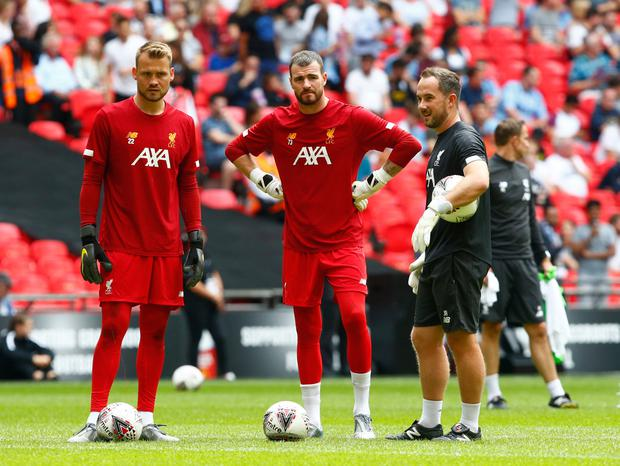 Safety net: Andy Lonergan (centre) could be offered a short-term deal to ease Liverpool's goalkeeper issues. Photo: Action Foto Sport/NurPhoto via Getty Images