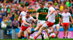 Stephen O'Brien times his run to perfection before slotting home Kerry's goal despite the efforts of Tyrone's Ronan McNamee and Frank Burns. Photo by Eóin Noonan/Sportsfile