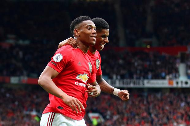 Manchester United's Anthony Martial celebrates with Marcus Rashford after scoring against Chelsea. Photo by Julian Finney/Getty Images