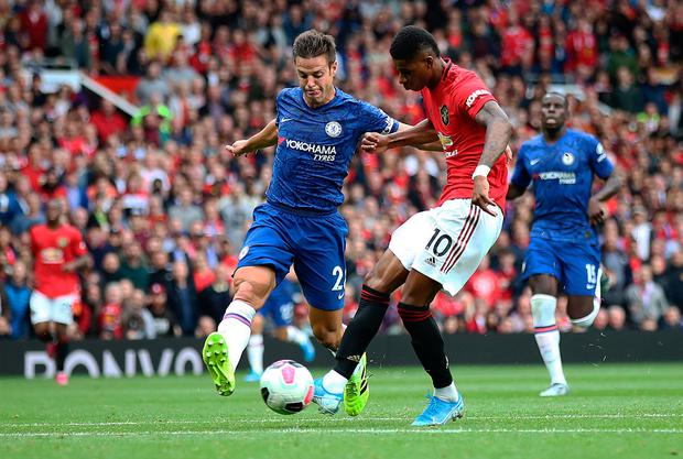 Marcus Rashford of Manchester United scores the third goal. Photo by Julian Finney/Getty Images