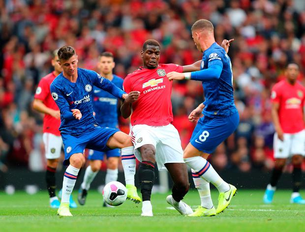 Paul Pogba of Manchester United battles for possession with Mason Mount and Ross Barkley of Chelsea. Photo by Julian Finney/Getty Images