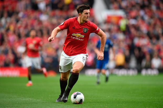 New faces: Harry Maguire takes the ball forward during an impressive Manchester United debut against Chelsea. Photo: Getty Images