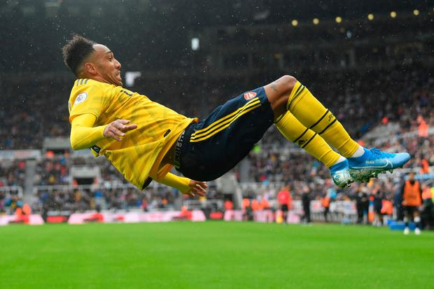 Pierre-Emerick Aubameyang of Arsenal celebrates after scoring his team's first goal. Photo by Stu Forster/Getty Images
