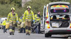 Help: Firefighters and gardaí at the scene of the incident at Firgrove, near Shannon, Co Clare, where six cyclists were injured. Photo: Press 22