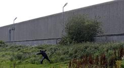 Method: Drugs being thrown over the perimeter wall of Wheatfield Prison from adjacent waste ground