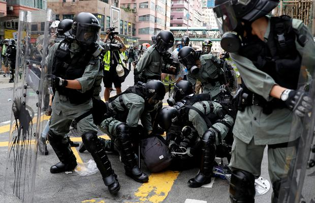 Scuffle: Riot police detain a protester during a march in Sham Shui Po, Hong Kong. Photo: Reuters