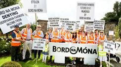 Protestors from Derryarkin, Co Offaly pictured outside the Bord na Móna headquarters in Newbridge, Co Kildare last week. Photo: Aishling Conway