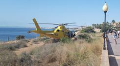 Rescue: A helicopter lands near the scene of the accident at Cabo Roig near Torrevieja, Spain