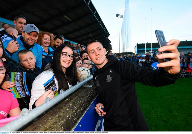 12 August 2019; Con O'Callaghan of Dublin takes a selfie with Ella Phelan, age 16, from Ballymun, Co Dublin during a meet and greet at Parnell Park in Dublin. Photo by David Fitzgerald/Sportsfile