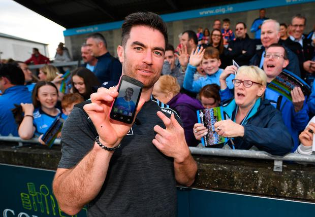 Michael Darragh Macauley of Dublin shows off the phone background of supporter Martina McHugh from Blessington, Co Dublin, right, during a meet and greet at Parnell Park in Dublin. Photo by David Fitzgerald/Sportsfile