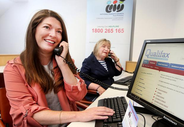 Advice: Roisin O'Donohoe and Honor McAndrew from the Institute of Guidance Councillors manning the Leaving Cert Helpline. Photo: Steve Humphreys