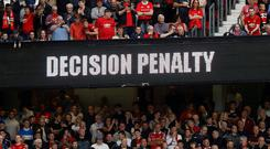 VAR (Video Assistant Referee) displays a decision of a penalty on a scoreboard. Photo: Martin Rickett/PA Wire