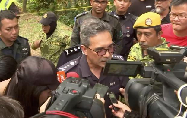 In this image from a video, Negeri Sembilan state police chief Mohamad Mat Yusop, center, speaks to media in Pantai, Malaysia Tuesday, Aug. 13, 2019. (AP Photo)