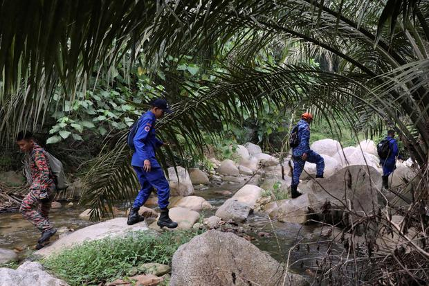 Members of Malaysian rescue team take part in a search and rescue operation for 15-year-old Irish girl Nora Anne Quoirin who went missing from a resort in Seremban, Malaysia, August 13, 2019. REUTERS/Lim Huey Teng