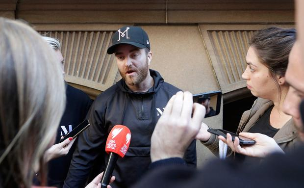 Paul O'Shaughnessy, center, tells how he and his brother Luke chased down a man who attempted to stab multiple people in Sydney, Australia, Tuesday, Aug. 13, 2019. (AP Photo/Rick Rycroft)