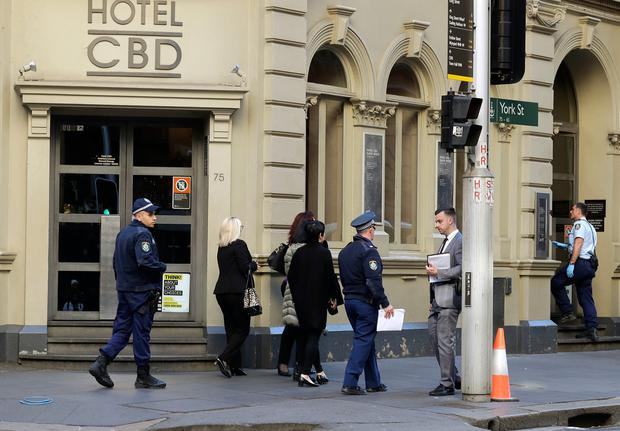 Police work at a scene where a man attempted to stab multiple people in Sydney, Australia, Tuesday, Aug. 13, 2019. (AP Photo/Rick Rycroft)