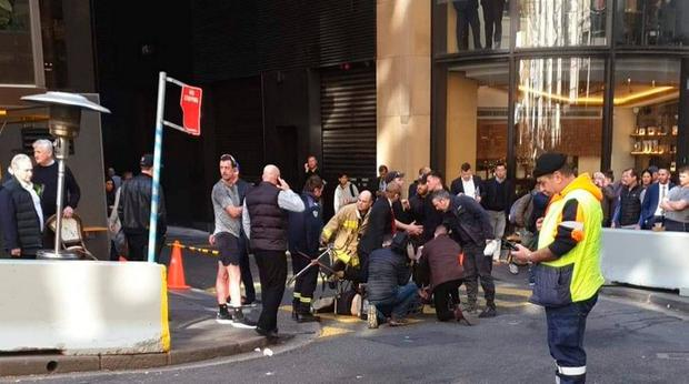 Handout photo taken with permission from the Twitter feed of @thisisbrodie of a man being tackled with a milk crate and chairs by members of the public in Sydney, Australia, following a knife attack. Brodie Smith/PA Wire