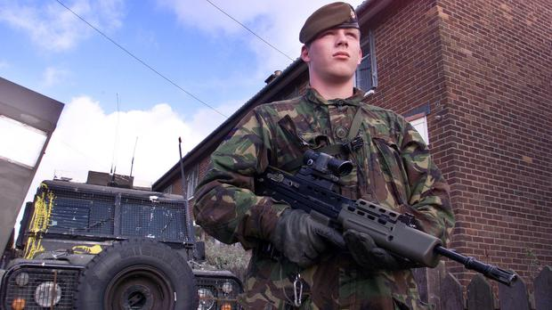 A British soldier on patrol in Ardoyne in North Belfast (Paul Faith/PA)