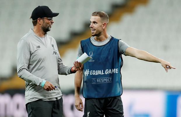 Soccer Football - UEFA Super Cup - Liverpool Training - Vodafone Park, Istanbul, Turkey - August 13, 2019 Liverpool manager Juergen Klopp and Jordan Henderson during training Action Images via Reuters/John Sibley