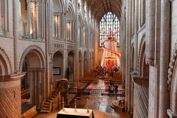 People view a 40ft helter skelter installed inside Norwich Cathedral as part of the Seeing It Differently project which aims to give people the chance to experience the Cathedral in an entirely new way and open up conversations about faith. Photo: PA