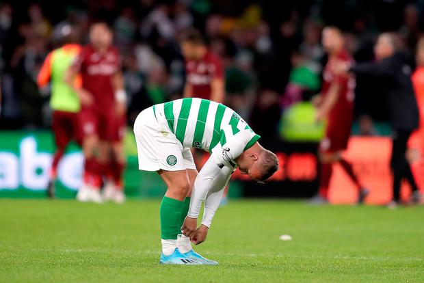 Celtic's Leigh Griffiths appears dejected after the final whistle during the UEFA Champions League third qualifying round second leg match at Celtic Park, Glasgow. Tuesday August 13, 2019. Jane Barlow/PA Wire