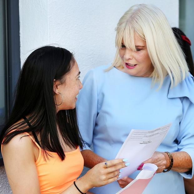 Minister Mary Mitchell O Connor chats with Mia Yip Breen from Shankill at Rockford Manor School in Blackrock. Photo: Steve Humphreys