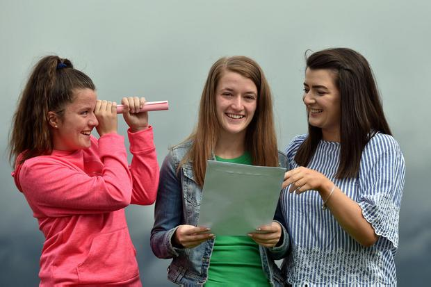 Ciara O'Sullivan (centre) with her sisters Aisling, left and Laura at Presentation School Milltown, Co. Kerry. Photo: Don MacMonagle