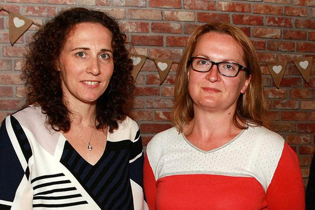 Anger: At a meeting advocating school bus seats for pupils in Creagh College were parents Alissa Walker and Catherine O'Connor