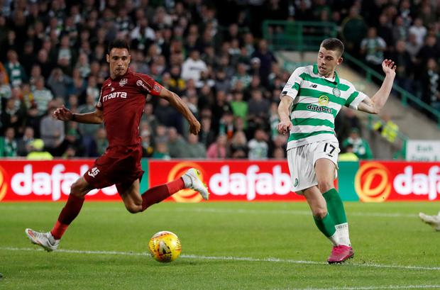 Celtic's Ryan Christie scores their third goal. Photo: Reuters/Russell Cheyne
