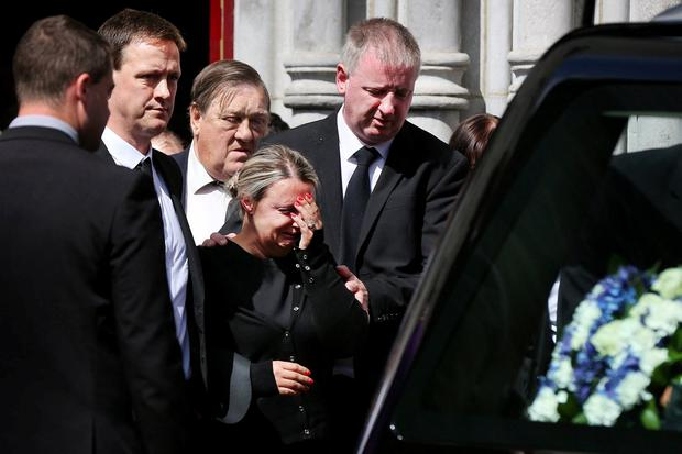Devastated: The parents of Mikey Leddy, Aisling and Damien, at their son's funeral at St Mary's Church in Navan. Photo: Steve Humphreys