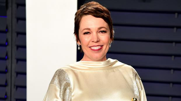 Olivia Colman did 'Claire Foy impressions' during first week filming The Crown (Ian West/PA)