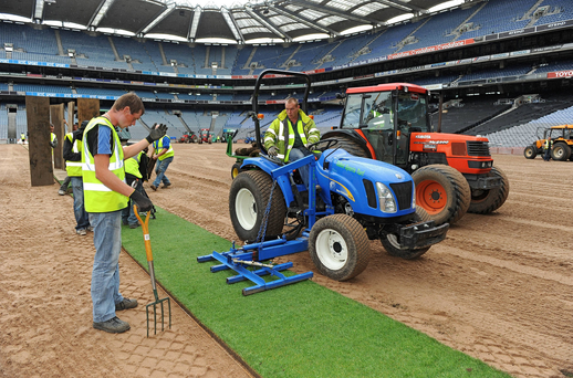 Planting: Workers lay sods of imported grass at Croke Park in 2009 but fresh grass from north Dublin was used on the pitch last month. Photo: Ray McManus/Sportsfile