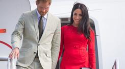 Prince Harry, Duke of Sussex and Meghan, Duchess of Sussex arrive at Fua'amotu Airport on October 25, 2018 in Nuku'Alofa, Tonga. The Duke and Duchess of Sussex are on their official 16-day Autumn tour visiting cities in Australia, Fiji, Tonga and New Zealand. (Photo by Dominic Lipinski - Pool/Getty Images)