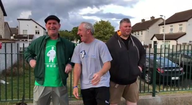 Former League of Ireland star Richie Parsons (centre) at a recent Jumpers For Goalposts event