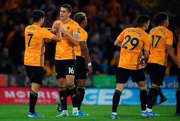 Pedro Neto celebrates with Conor Coady of Wolverhampton Wanderers after scoring during the UEFA Europa League third qualifying round win over FC Pyunik at Molineux