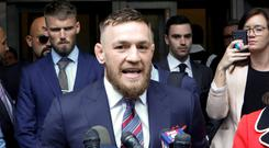 Conor McGregor: UFC fighter was dragged away from bar after incident. Picture: Reuters