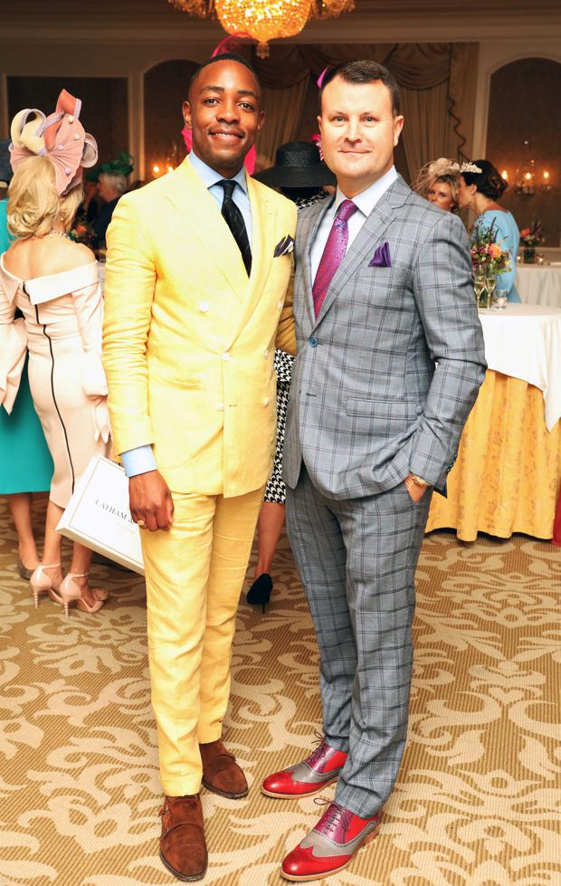 Lawson Mpame (left), who won the Best Dressed Man prize photographed with InterContinental GM Nicky Logue. Photo: Leon Farrell