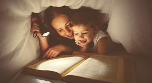 Research shows that reading books makes children happier than screen time