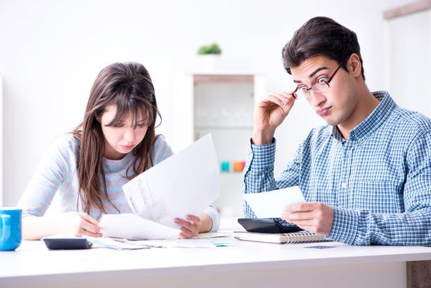 Juggling act: Many families struggle to prioritise their outstanding debt payments. Stock image
