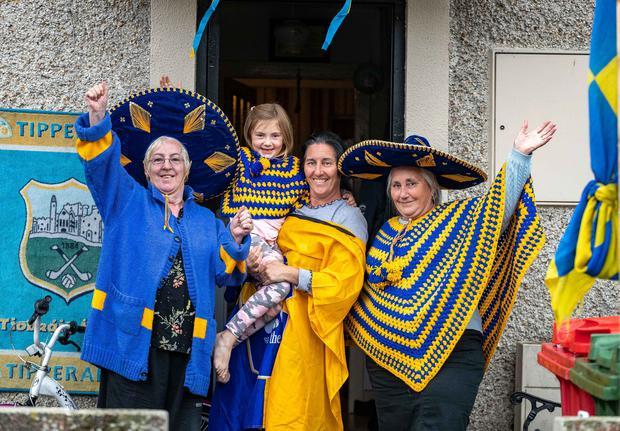 Kitted out: Noreen McGrath, Catherine Loughman holding Lacey Loughman (5) and Lily Loughman. Photo: Dylan Vaughan