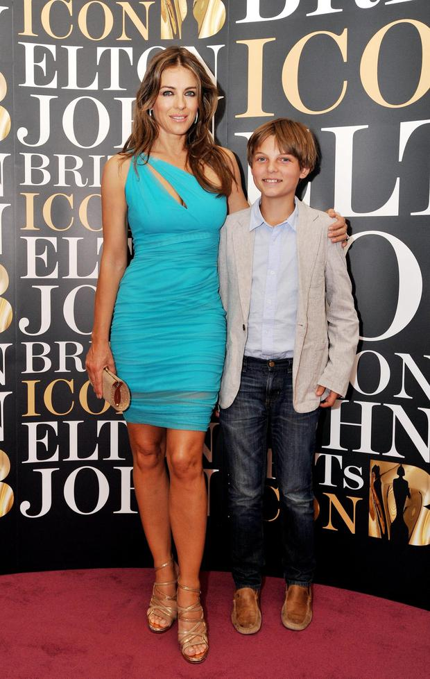 Liz and a young Damian pictured on the red carpet