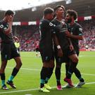 Liverpool's Roberto Firmino celebrates scoring their second goal with teammates Alex Oxlade-Chamberlain and Mohamed Salah
