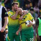 Norwich City's Teemu Pukki celebrates his hat-trick with the match ball after the match