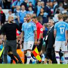 Manchester City manager Pep Guardiola reacts after the match as Kyle Walker looks on