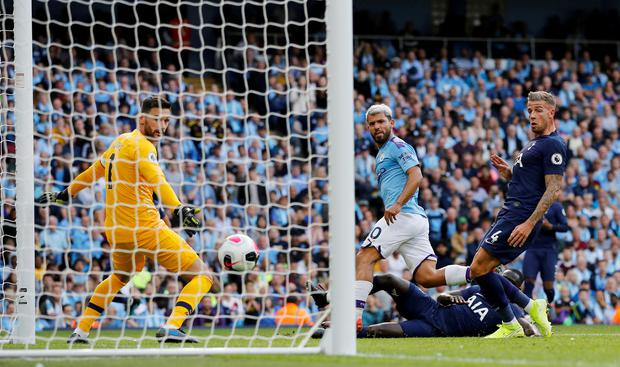 Manchester City's Sergio Aguero scores their second goal against Spurs yesterday. Photo: REUTERS/Phil Noble