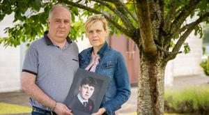 HEARTACHE: Parents Johnny and Elaine Downey with a photo of their only son Jack. Photo: Dylan Vaughan