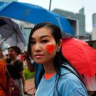 Disquiet: pro-Beijing supporter takes part in a rally at Tamar Park in Hong Kong. Photo: LILLIAN SUWANRUMPHA/AFP/Getty Images
