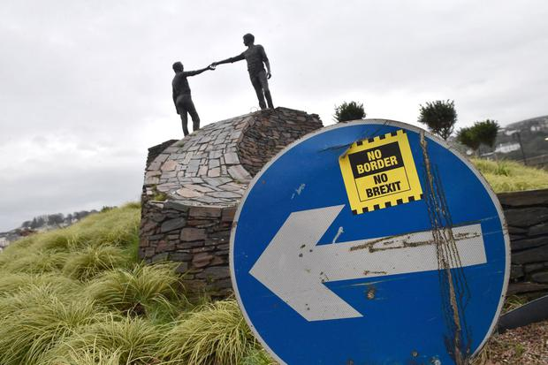 Trade: A No Border No Brexit sticker can be seen close to the Hands Across the Divide peace statue at Craigavon Bridge in Co Derry. Photo: Getty Images